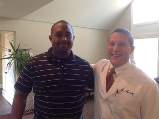 Patient with our chiropractor in Greenville, SC